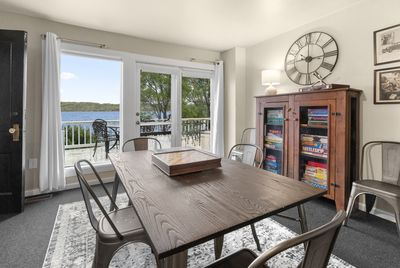 The game room has beautiful lake views and opens to a large deck.