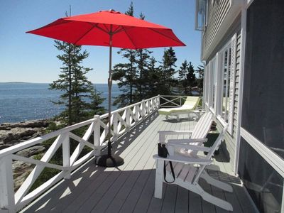 Large wooden decks surround the house