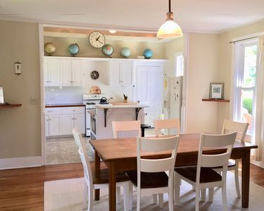 Dining room (8 chairs/table seats 8) with open kitchen beyond