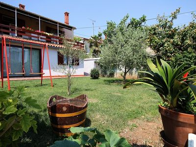 Photo for Apartment only 200 meters to the beach with washing machine, terrace, garden and barbecue
