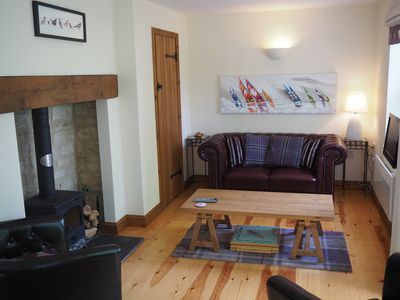 Comfortable traditional living area with games, TV and Log Fire