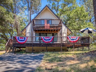 Photo for Cozy cabin in a gated community w/ shared pool, tennis, & lake access!