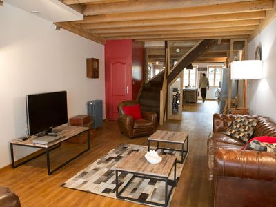 Photo for Town house at the foot of the abbey restored in a loft spirit with garden!