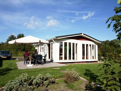 Photo for Comfortable chalets, situated round a pond in a small-scale holiday park