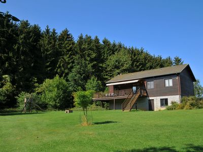 Photo for Cosy chalet with large garden and playground, located at the edge of the forest