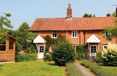 Photo for This attractive, traditional Norfolk cottage enchants and envelops its occupiers.