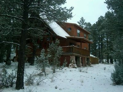 Cabin has wrap around deck and sits on one acre