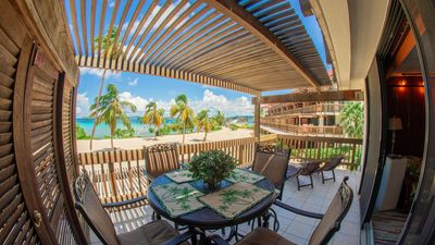 Photo for Corner unit with unobstructed views of Sapphire Beach which is steps away...