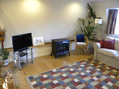 Sitting room with freeview TV, DVD, electric fire