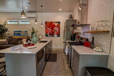 Well equipped kitchen with coffee maker, blender, microwave, dishwasher