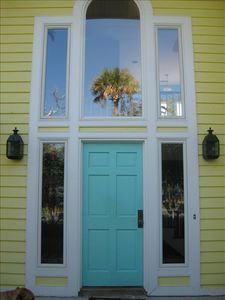 Welcome to our home - we love the blue front door and the open floor plan.