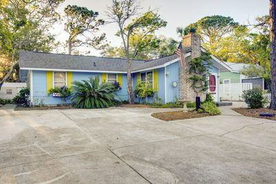 This charming Tybee Cottage has lots of room inside and out to gather with family and friends