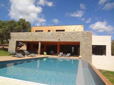 Photo for modern and contemporary villa with heated pool near the sea.
