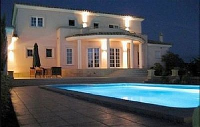 Villa at night time! Rear view of villa and pool area.