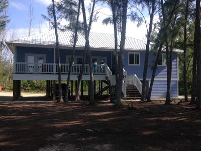 the view of the house and large back porch from the beach