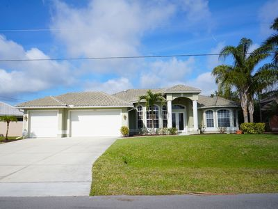 Photo for Lazy Daze 1012  SW Cape Coral Waterfront Pool Home with electric heated pool spa gulf access canal