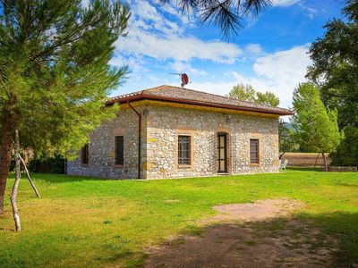 Photo for A rustic house set in the Tuscan landscape.