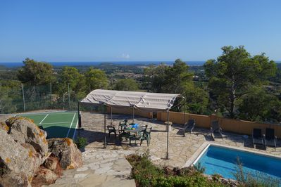 Panoramic sea view from the main terrace showing private pool & badminton cour