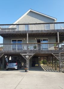 Photo for Mile 7: Walk to the Beach and Puttx2 while staying at this Charming reTREAT