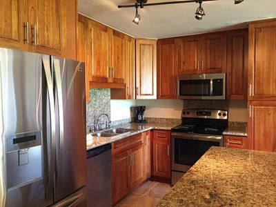 Newly renovated kitchen with stainless steel appliances and granite countertops.
