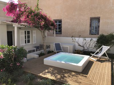 Photo for The Garden house in Oia with hot tub