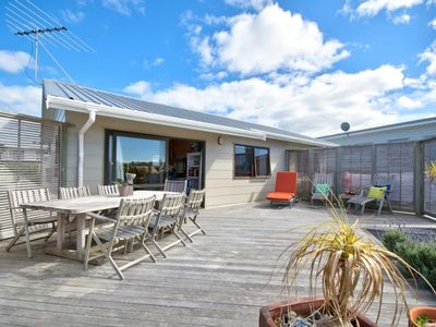 Photo for Relaxing sun drenched beach house with sea views