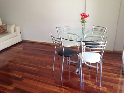 Dinig table with 4 chairs in very bright area