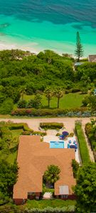 Aerial view of the villa show its proximity to the beach.