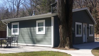 Photo for Cozy comfortable cottage. Nestled on lake shore drive. Walking distance to beach