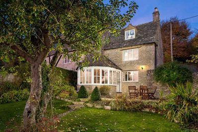 A lovely view of the cottage in twilight