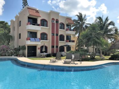 Photo for Beachfront Condo with large pool, steps from the beach, and walk to town square