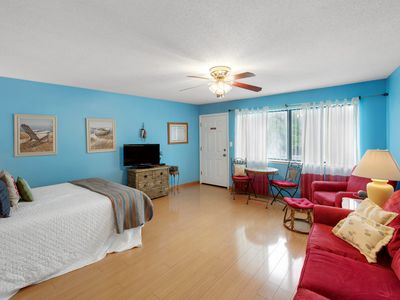 Photo for Coastal style condo, steps to the beach, quick ride to entertainment