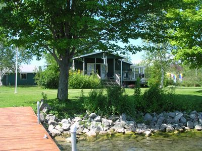 Photo for A bright two-bedroom cottage on beautiful Bass Lake near Orillia