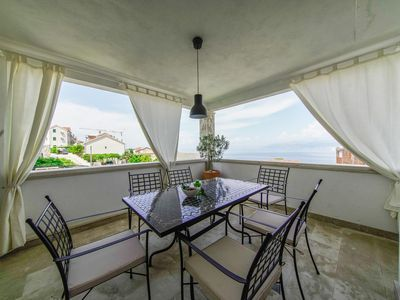 Photo for One bedroom apartment with terrace and sea view Postira, Brač (A-2913-c)