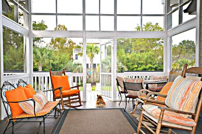 Screened porch overlooks pool and yard. Table, rockers, glider. Ceiling Fan.