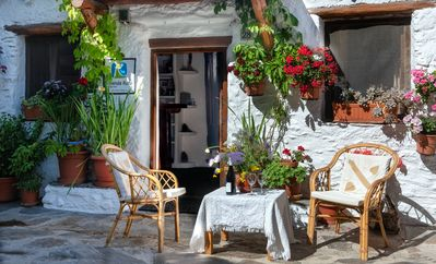 Photo for Peaceful comfort with mountain walks from La Alpujarra's nicest village. WiFi.