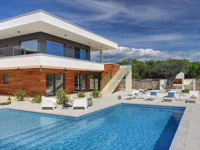 Photo for Luxury villa for 10 people with private pool, 5 air-conditioned bedrooms, sauna, BBQ, sea views and a games room