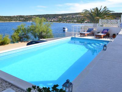 Photo for Holiday beach house with private heated pool  and buoy