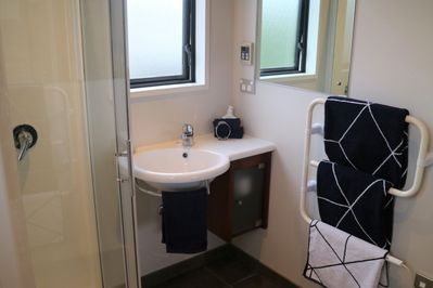 Clean, modern bathroom. Fresh towels, facecloth and hand towel provided.