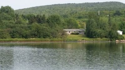 view of house and property from water