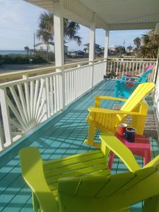 Photo for BEAUTIFUL views!  Relaxing porch and pool!  Pet friendly, steps to the beach.