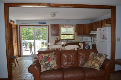 Open floor plan with kitchen, dining, living room and 1st floor washer/dryer.