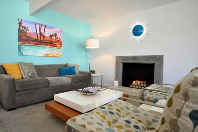 The Living room with Tiffany accent wall, fine furniture, art & modern fireplace