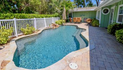 Beautiful HEATED saltwater pool w/ soothing waterfall & patio with gas BBQ grill