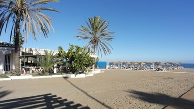 Photo for BEACH FRONT building,Modern Apt, Sea view.s Sunny Terrace, Lovely Pools & Garden
