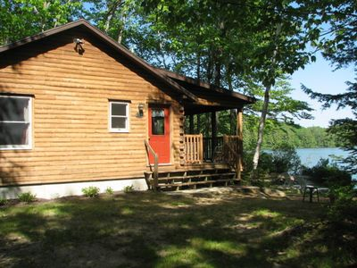Photo for Cozy Cedar Log Cabin on Pristine Sand Pond in Norway, great for swimming.
