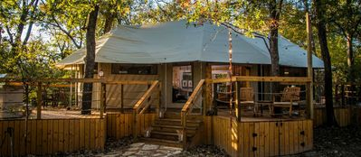 Your luxurious safari tent with gorgeous wrap-around deck in a magical forest