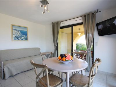 "Photo for spacious apartment ""olive"" twith private garden, deckchair, barbecue, pool, 5 min from the beach"