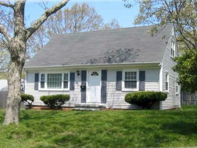 Classic Cape with hardwood floors downstairs, 4 bedrooms, 2 baths, 2 living room