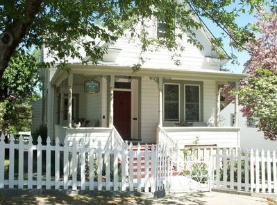 Welcome! Enjoy a cup of coffee & a good book on our charming wrap around porch!